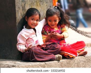 Kids sitting on the street of Kathmandu Nepal