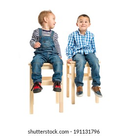 Kids sitting on a wooden chair over white background