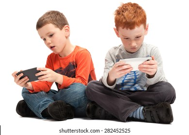 kids sitting playing on mobile phones