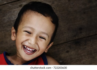 Kids Smile And Looking At Camera