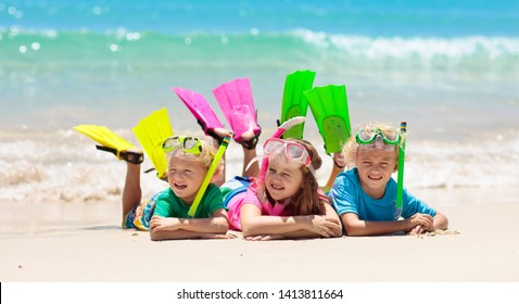 Kids snorkel. Beach fun. Children snorkeling in tropical sea on family summer vacation on exotic island. Child with mask and fins. Travel with young kid. Boy and girl learning to dive. Diving holiday.
