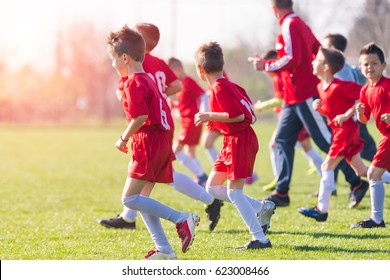 Kids soccer football - small children players exercising before match on soccer field