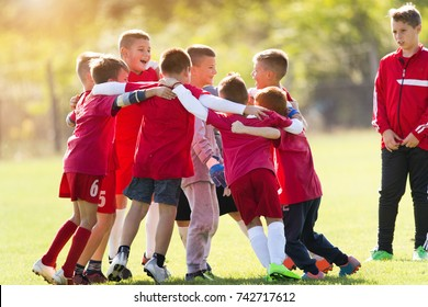 Kids soccer football team in huddle