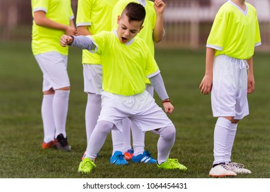 Kids soccer football - young children players celebrating