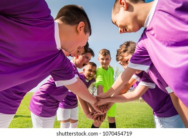 Kids soccer football - young children in hudle