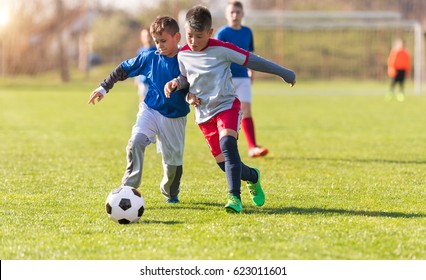 Kids soccer football - young children players match on soccer field