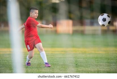 Kids soccer football - young children players match on soccer field
