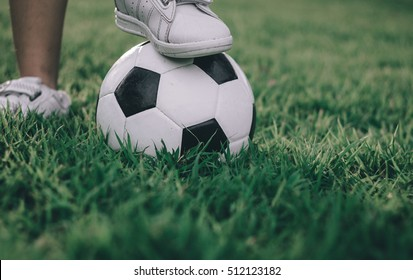 kids in soccer game at outdoors  / soft focus / selective focus / Japanese Tone