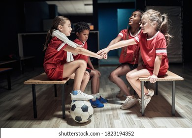 Kid's soccer team building up togetherness in a locker room