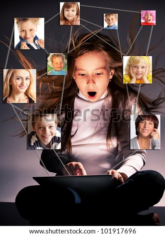 Kids in social network. Child looks to the tablet computer. Social group