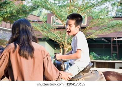 Kids with special needs are riding with a close supervision teacher. This is a treatment called Hippo therapy. Happy disabled child concept.