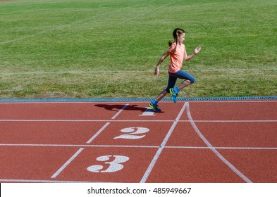 Kids sport, child running on stadium track, training and fitness concept