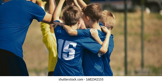 Kids Sport Team Gathering and Rising Hands. Children Play Sports. Boys in Sportswear Jersey Uniforms Having Shout Team. Youth Sports For Children. Youth Football Academy Background with Copy Space