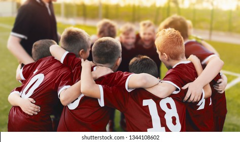 Kids Sport Team Huddle. Boys of Soccer Team Gathered Before the Tournament Final Match. Coach and Young Football Players Huddling