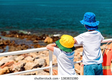 Kids standing on a ferry deck and watching the sea on the way to Kangaroo Island