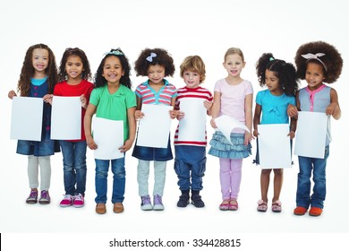 Kids standing together holding large white sheets against a white background