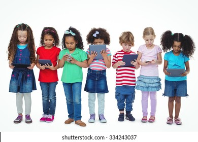 Kids standing together holding tablets and phones against a white background