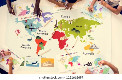 Kids studying geography in school