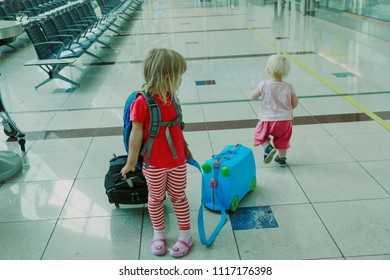 kids with suitcase travel in the airport