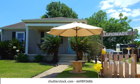 Kids summer wooden lemonade stand in front of house