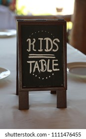 Kids table at a wedding.