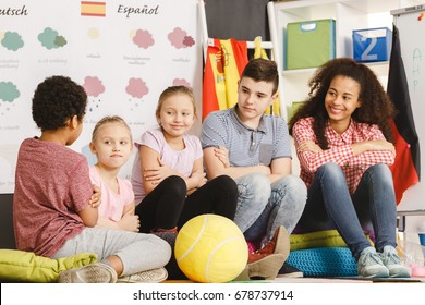 Kids and teacher talking in group during spanish classes
