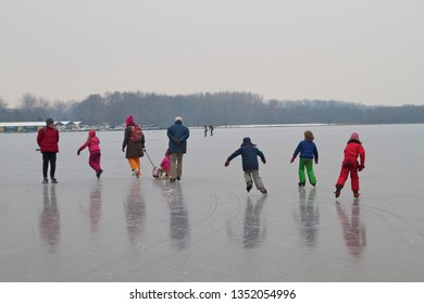 Kids, teenagers and grown-up enjoying ice scating on the Amsterdam lake the Nieuwe meer in the Netherlands.