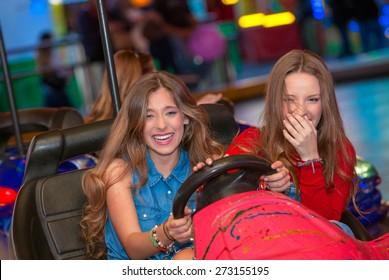 kids or teens on fairground ride dodgem bumper cars