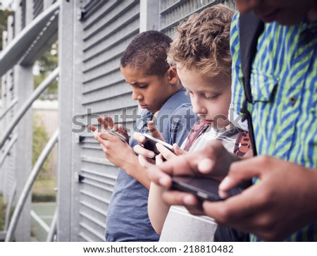 kids texting message on smartphone