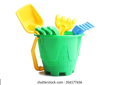 Kids toy bucket with shovel and rake isolated on white background