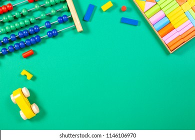 Kids toys background with abacus, toy car and wooden cubes