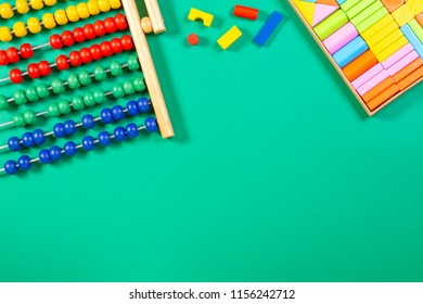 Kids toys background with abacus and wooden cubes