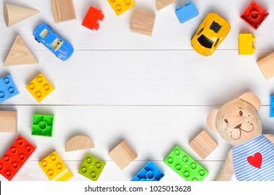 Kids toys background with teddy bear and colorful blocks. Copispace background. Top view.
