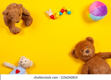 Kids toys background with teddy bear and colorful toys