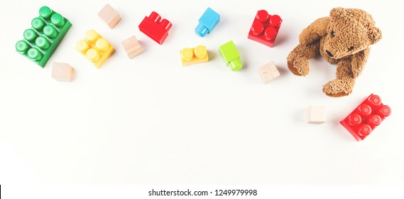 Kids toys background with teddy bear and colorful cubes blocks