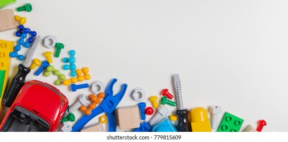 Kids toys banner background. Toy tools, bolts, nuts, car, construction blocks, cubes on white background