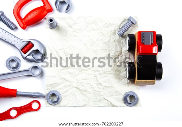 Kids toys frame background. toy tools, construction  on white background. Top view. Flat lay. Copy space for text
