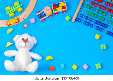 Kids toys frame on blue background. Top view. Flat lay. Copy space for text