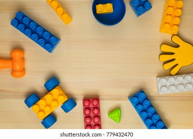 Kids toys frame on wood background. Top view. Flat lay. Copy space for text