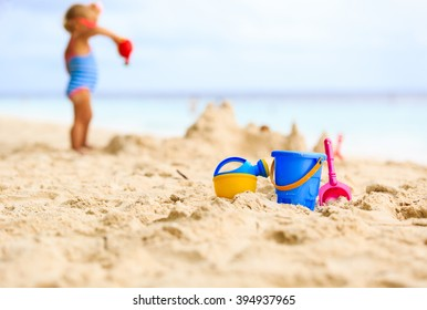 kids toys and little girl building sandcastle