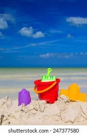 kids toys on white sand beach