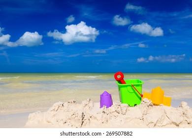 kids toys on white sand tropical beach