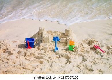kids toys and sandcastle on beach