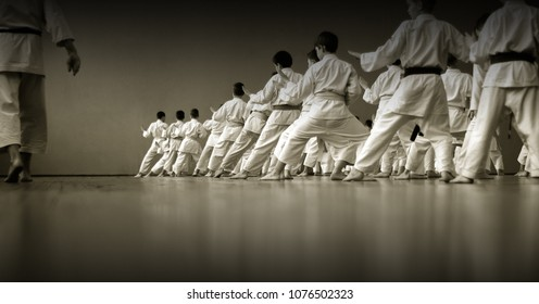 Kids training on karate-do.  Black and white. Photo without faces, from the back.