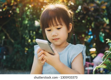 Kids using smart phone : Some research says entertainment media (including TV) be avoided for infants and children under age 2 and cell phone radiation can harm your baby and may cause of ADHD.