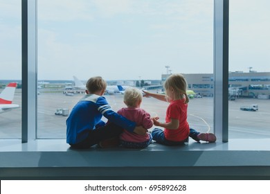 kids waiting for plane in airport