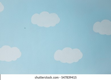 Kids wallpaper of blue sky with clouds in the interior of the room