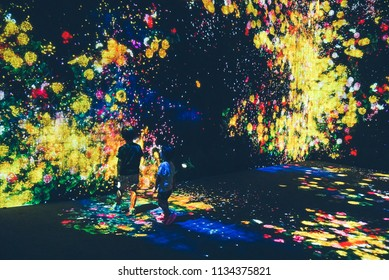 Kids watched on as flowers 'bloom' on the walls in in a permanent exhibition by teamLab in the Mori Digital Art Museum. Picture taken in Tokyo, Japan on 14 July 2018.