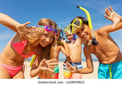 Kids waving hands wearing scuba snorkeling masks