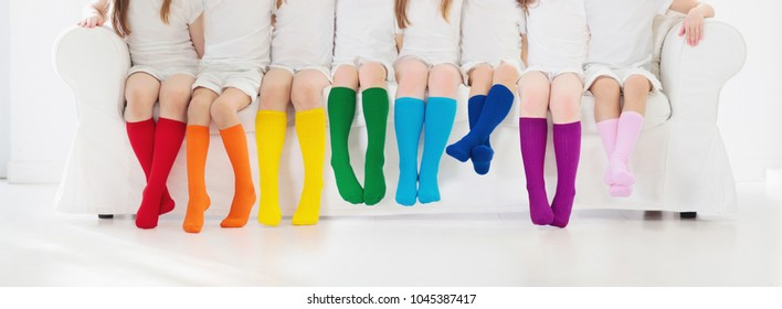 8d854a1c7 Kids wearing colorful rainbow socks. Children footwear collection. Variety  of knitted knee high socks